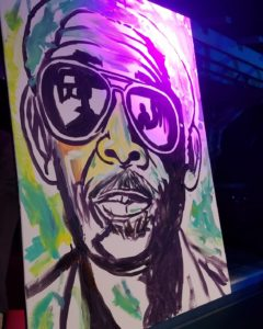 Jamal Rolle paints a masterpiece live at the Julien Believe video release party for going down on bay. Bahamas